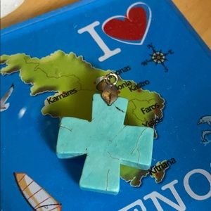 Cross pendant of real turquoise stone